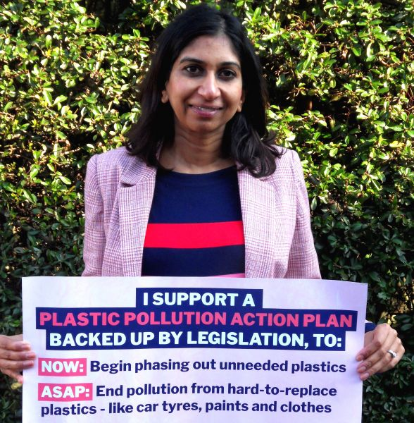 Suella Braverman, Conservative MP for Fareham, holding up a banner to declare support for a law to phase out non-essential plastics