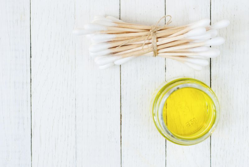 Cotton buds and skincare oil