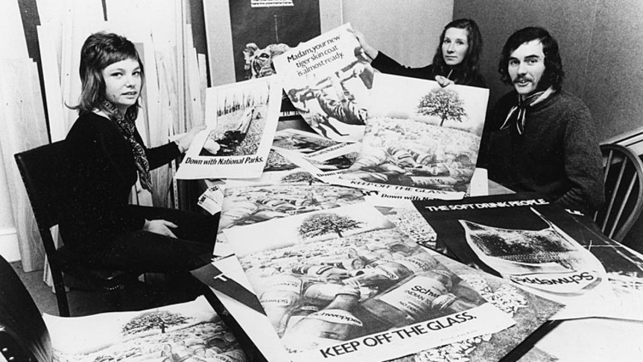 Anfel Potter (centre) and colleagues display early Friends of Earth campaigning materials, 1971.
