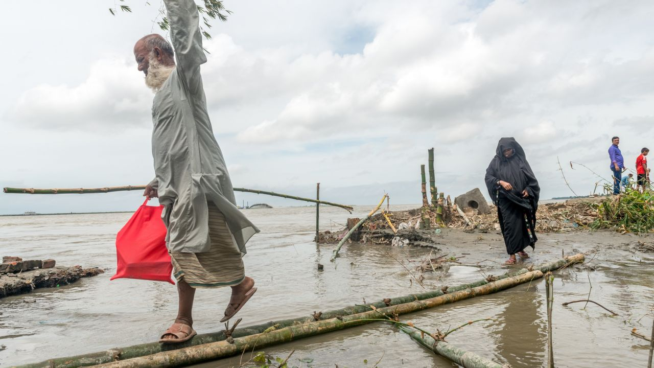 Heavy flooding from monsoon rain and tide from river in Dohar, Bangladesh