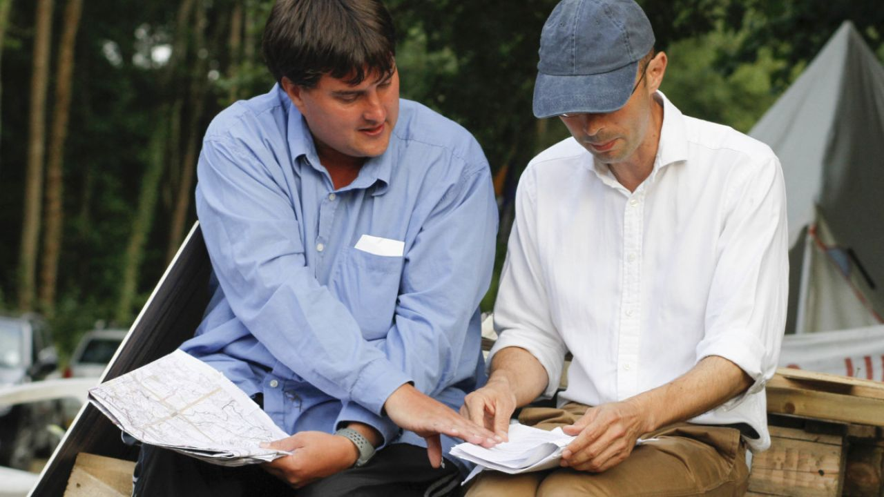 Friends of the Earth's environmental lawyer Jake White talks to local resident, Carl Lee, at a demonstration in Balcombe, West Sussex, against oil exploration by Cuadrilla, 7 August 2013.