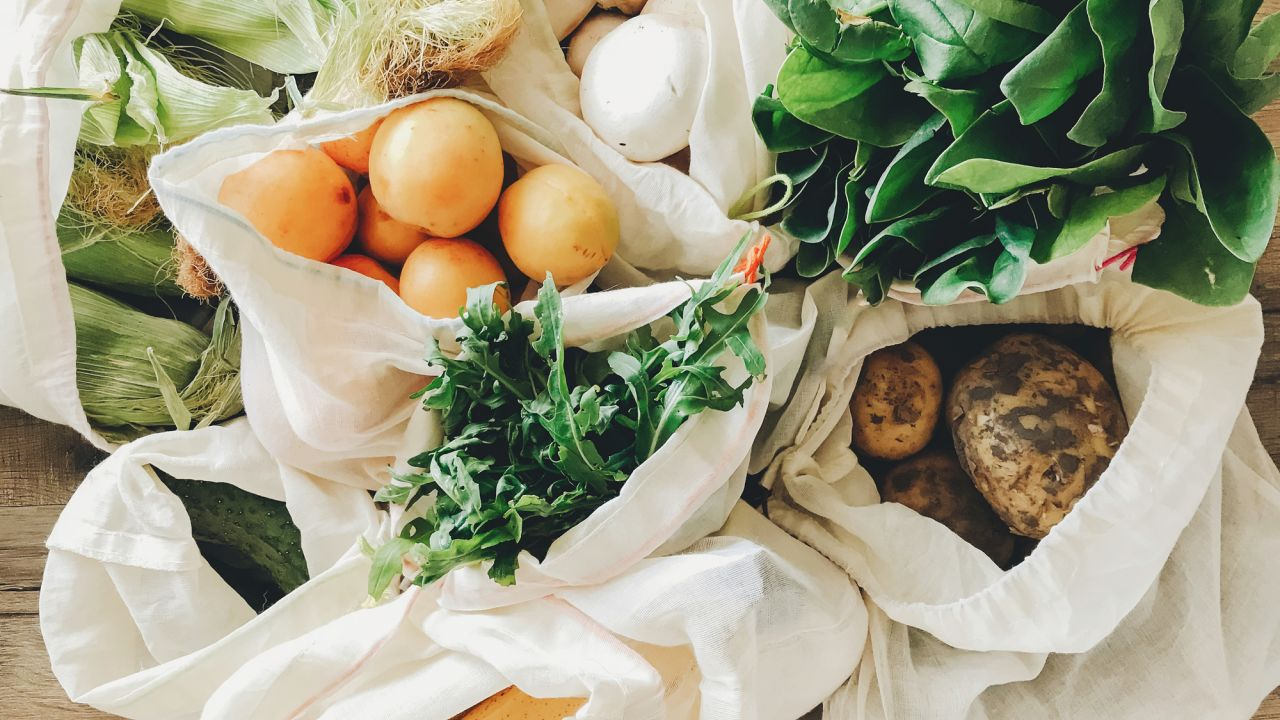 Zero waste solution: several tote bags containing groceries