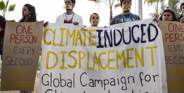 photo of protest against climate induced migration at COP22