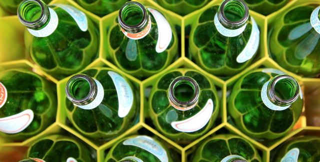 Empty glass bottles in a crate, waiting to be returned for reuse/recycling