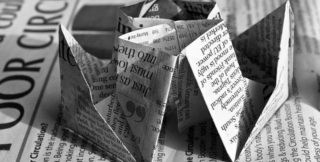Waste newspaper folded into the shape of a boat
