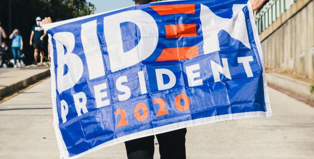 Person holding Biden President 2020 flag
