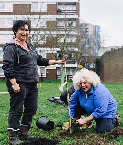Members of the Urban Orchard Project getting their hands dirty