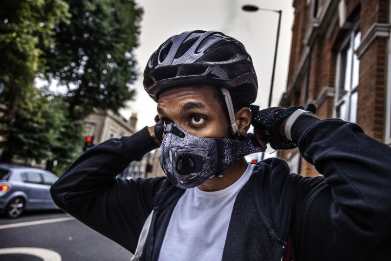 photo of cyclist with mask