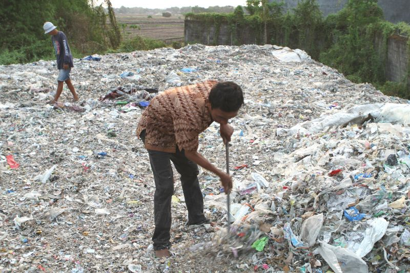 Man picking through plastic waste in Surabaya
