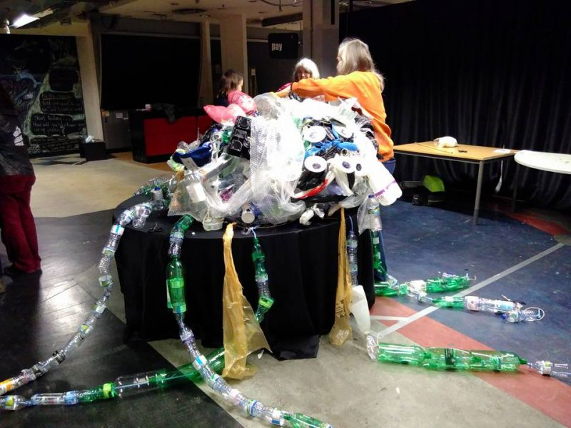 Shoppers help to build a sea monster from plastic waste