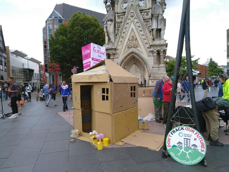 Leicester Friends of the Earth in street with cardboard shed protest against permitted developments.