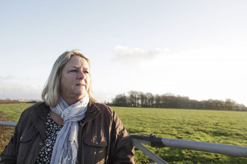 Barbara standing by the proposed fracking site (Roseacre wood), which is behind her.