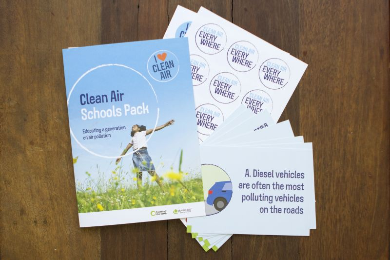 Friends of the Earth's Clean Air Schools Pack, showing cover, stickers and worksheets.