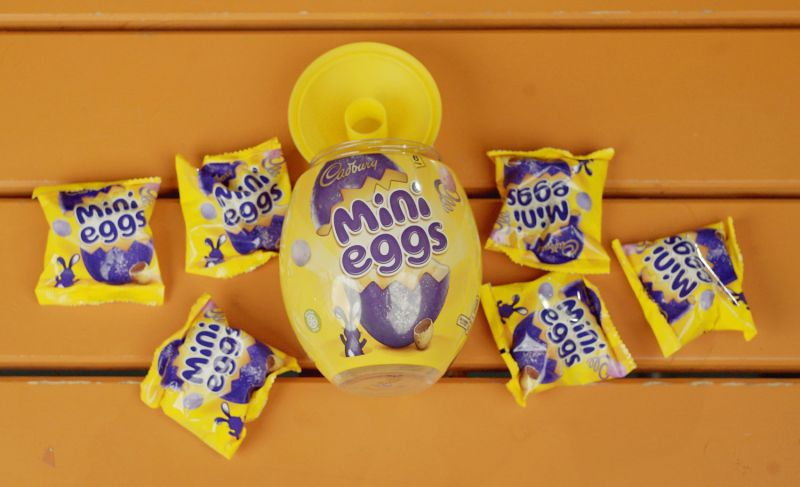 Packets of Cadbury mini eggs, emptied out of plastic egg container