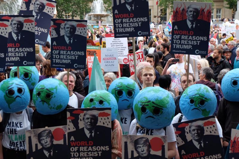 Earth heads from Friends of the Earth protest Trump's visit, 2019