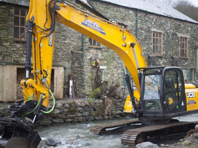 Diggers clear the beck in Glenridding, Cumbria in 2015 floods