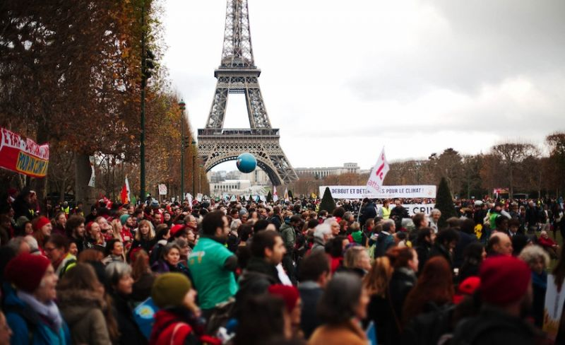 photo of demonstrators at Paris climate talks