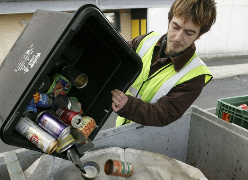 Worker collecting recycling, emptying bin