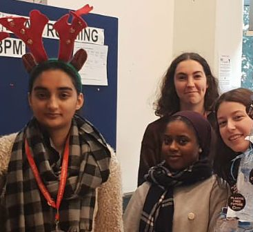 Lily (back, centre) with her fellow students