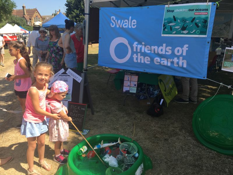 Children enjoy fishing plastic waste out of the 'sea'