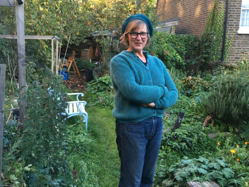 Kate Poland, the postcode gardener for Daubeney Road in Hackney, standing in her garden