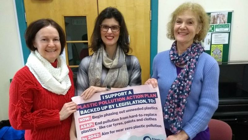 Layla Moran, Liberal Democrat MP for Oxford West and Abingdon, flanked by members of Oxford Friends of the Earth, holding up a banner to declare support for a law to phase out non-essential plastics