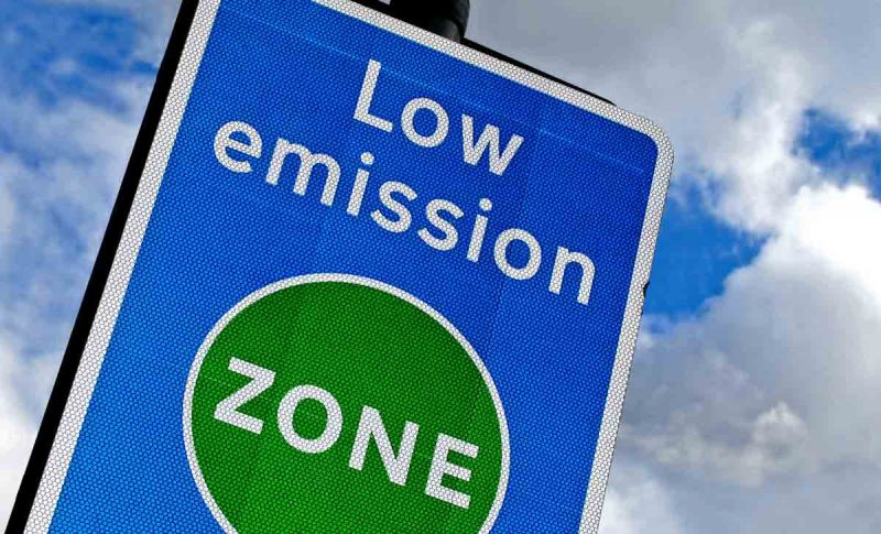 Blue and green Low Emission Zone road sign, London