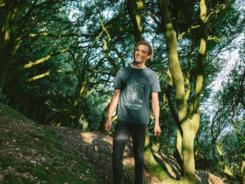 Man in woodland wearing Mighty Oaks tshirt