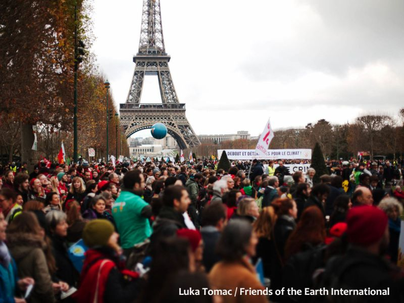 A crowd of people demonstrating at the UN climate talks in Paris, France, December 2015.