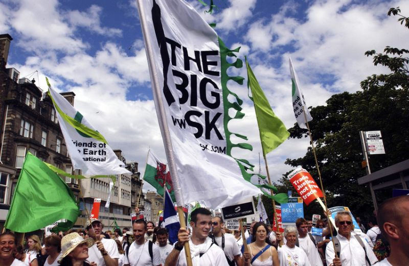 photo of peaceful march with Big Ask campaign banners