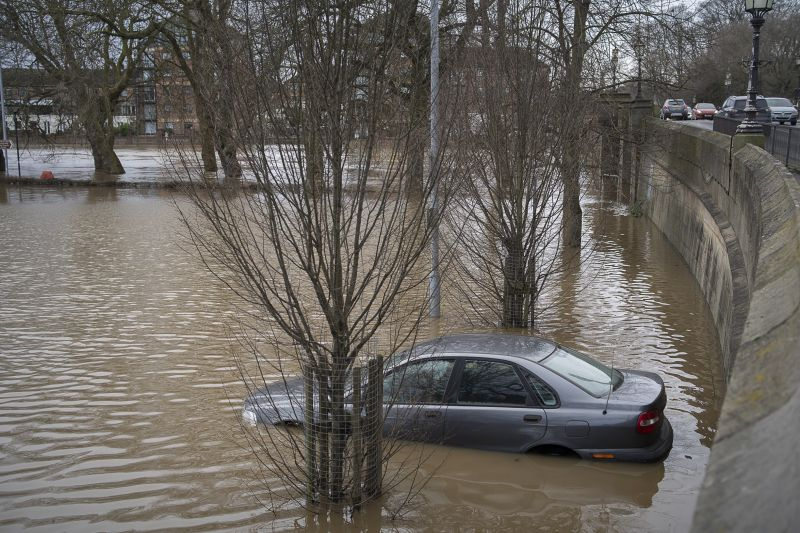 A car park with car submerged after flooding in York, 2020.