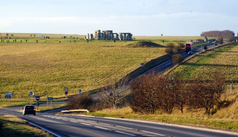 Stonehenge in distance and roads running close to Stonehenge.