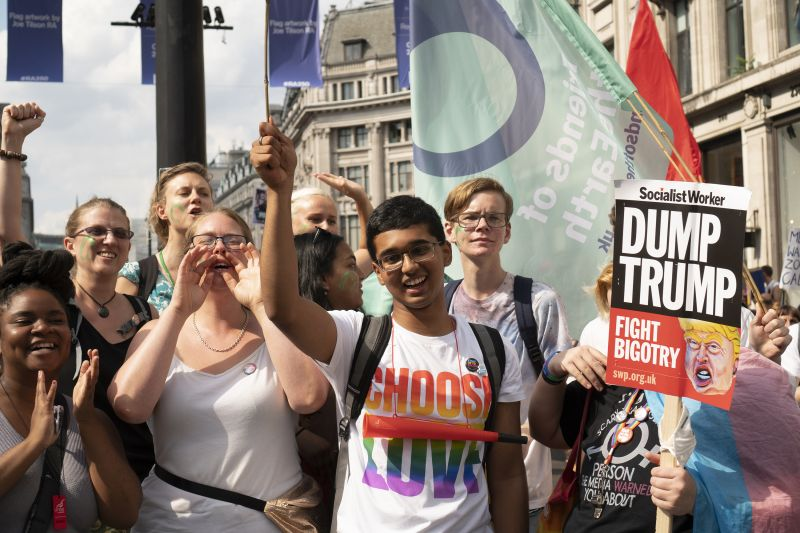 8 My World My Home students with banners and trainer attend the anti-Trump march in London July 2018