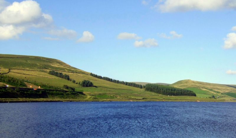 Woodhead Pass above reservoir in Peak District National Park with hills