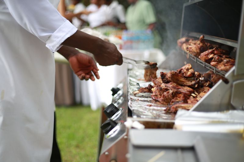 Catering barbecue showing hands of chef