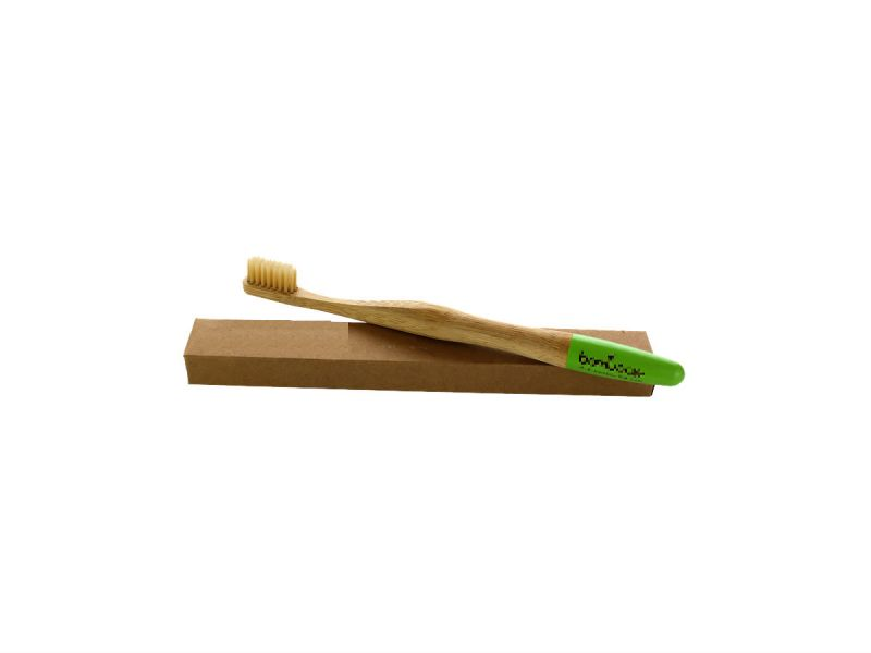 A bamboo toothbrush and box