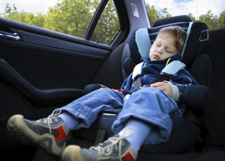 Child asleep in car seat