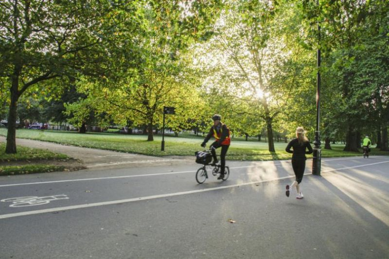 Cyclist and jogger in a park
