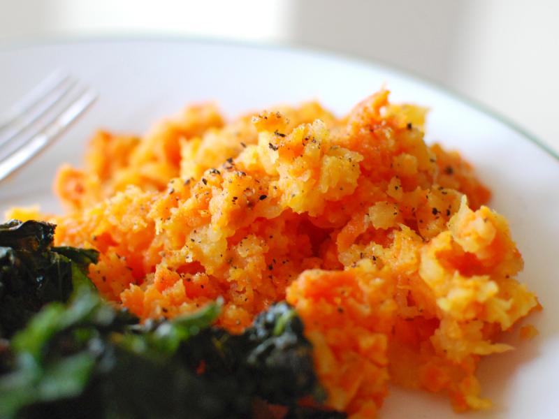 Plate of root vegetable mash and greens