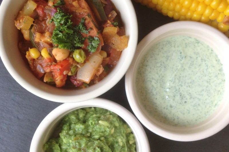 Vegetarian chilli with homemade guacamole, yoghurt and sweetcorn, in pots