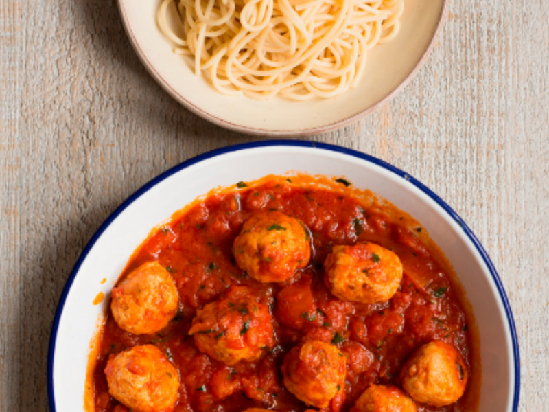 Bowl of money saving low-meat meatballs and spaghetti