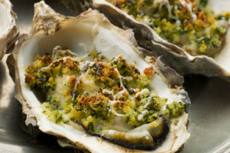 3 warm oysters in their shells, topped with garlic breadcrumbs