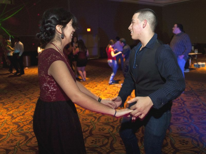 Two people dance together at the Latino Ethnic Awareness Association hosting a Salsa/Merengue/Bachata Dance