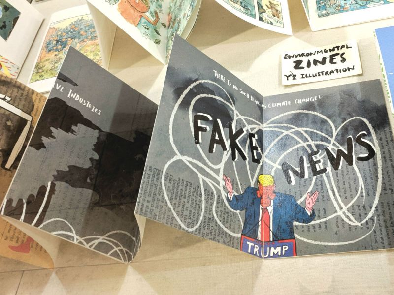 An environmental zine with an illustration of Trump in a gas mask, denying climate change