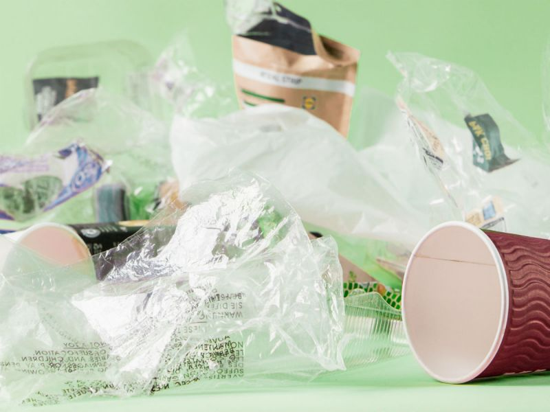 Examples of everyday plastic waste in our lives including disposable coffee cups and food packaging