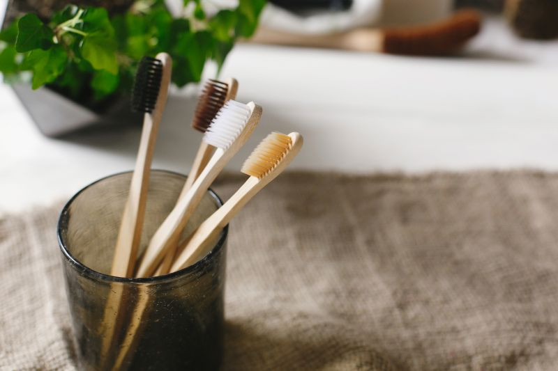 Bamboo tootbrushes in a glass jar
