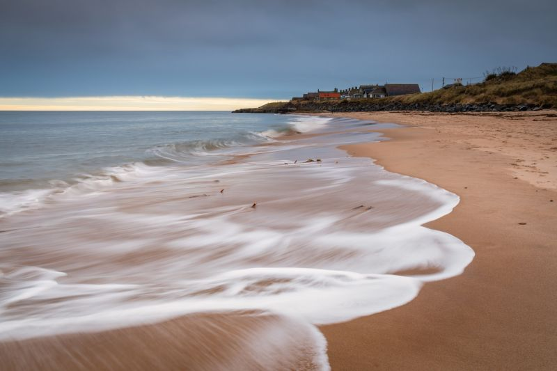 photo of Cresswell Village from the beach at Druridge Bay