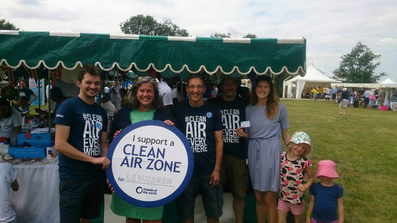 Clean Air Week of Action stall Lewisham with people holding Clean Air Zone sign