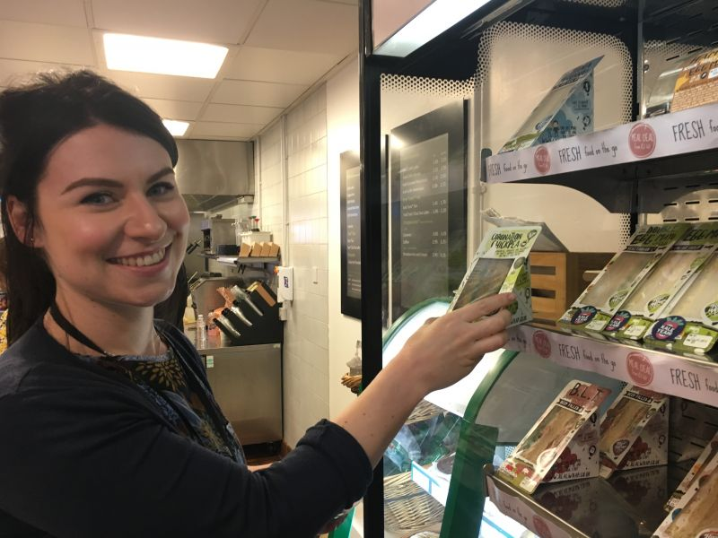 Rachel Stone choosing a KaleYeah! veggie sandwich at one of the university's cafes.