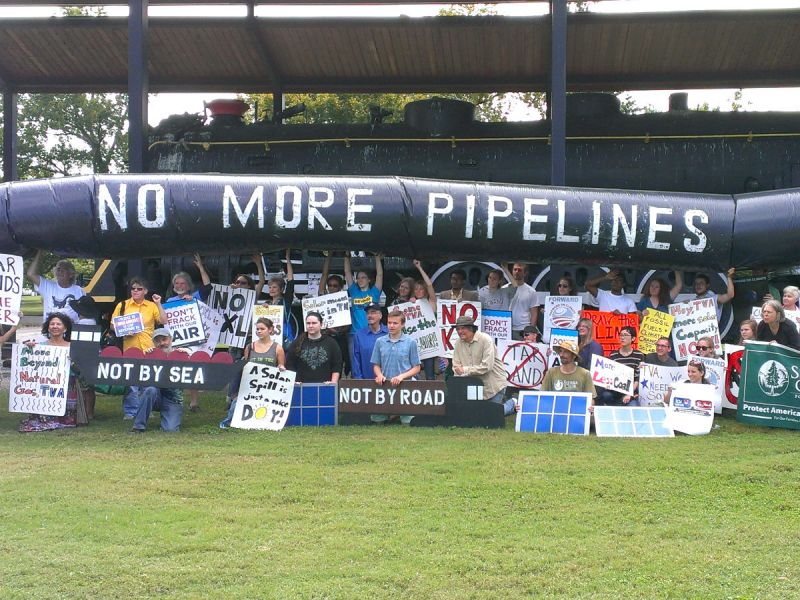 People holding up a fake pipeline to protest against the Keystone XL pipeline in Nashville, United States.
